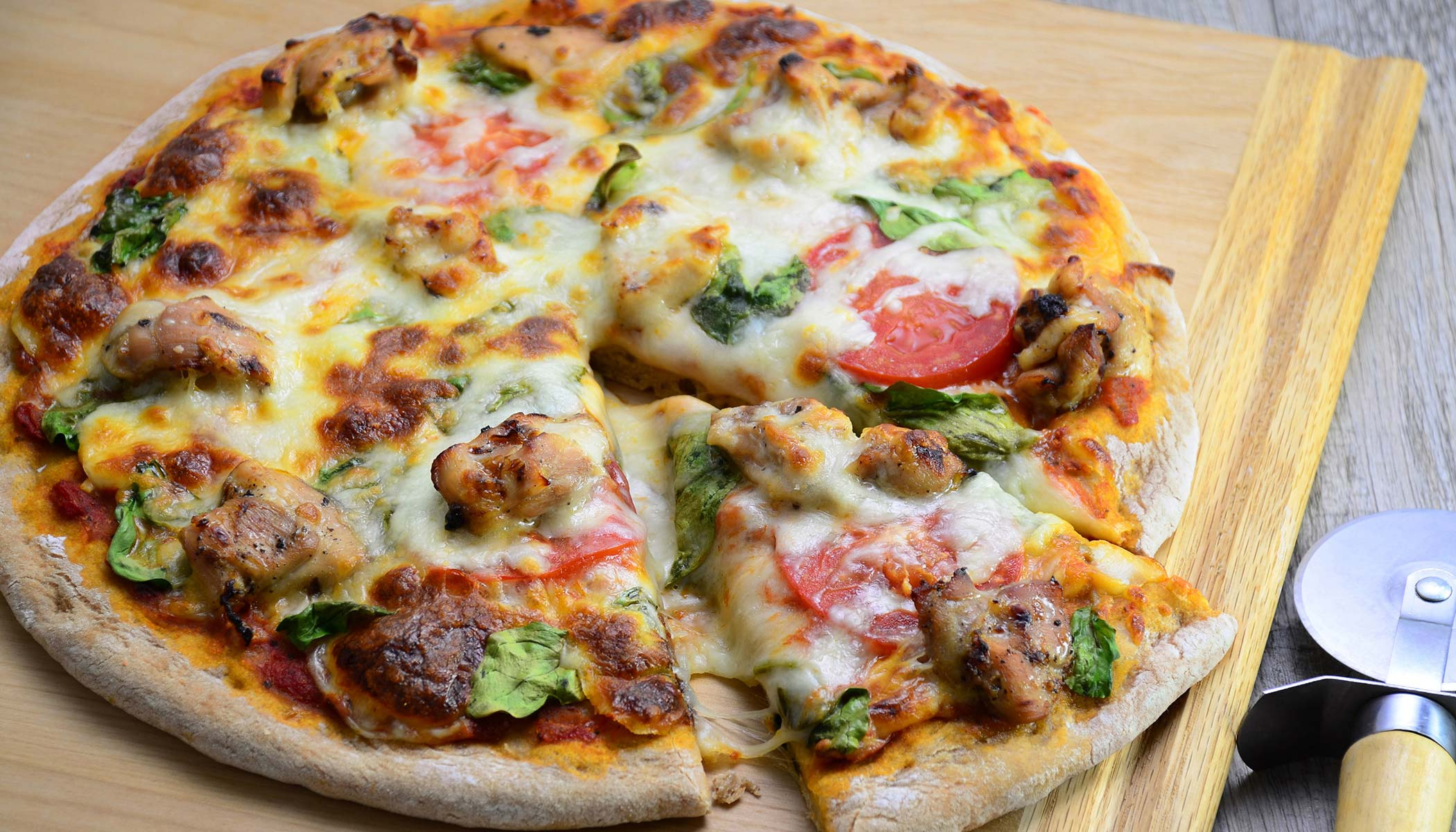 Whole Wheat Chicken Pizza with Spinach and Fresh Tomatoes